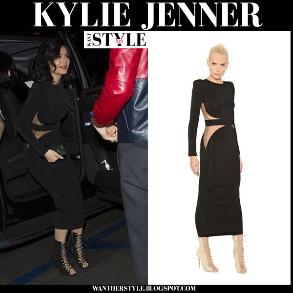 Kylie Jenner in black long sleeve dress with sheer inserts from Balmain what she wore
