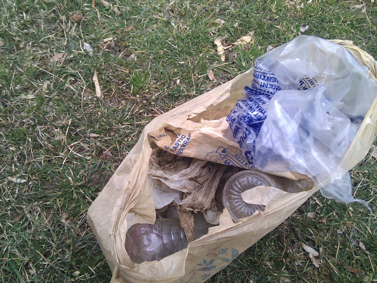 A bag of trash collected in the park