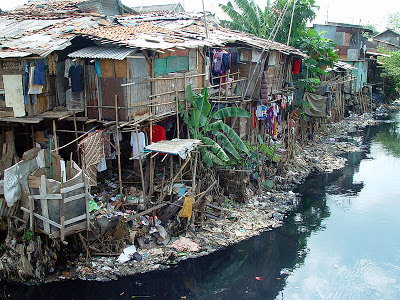 slum houses beside the creek