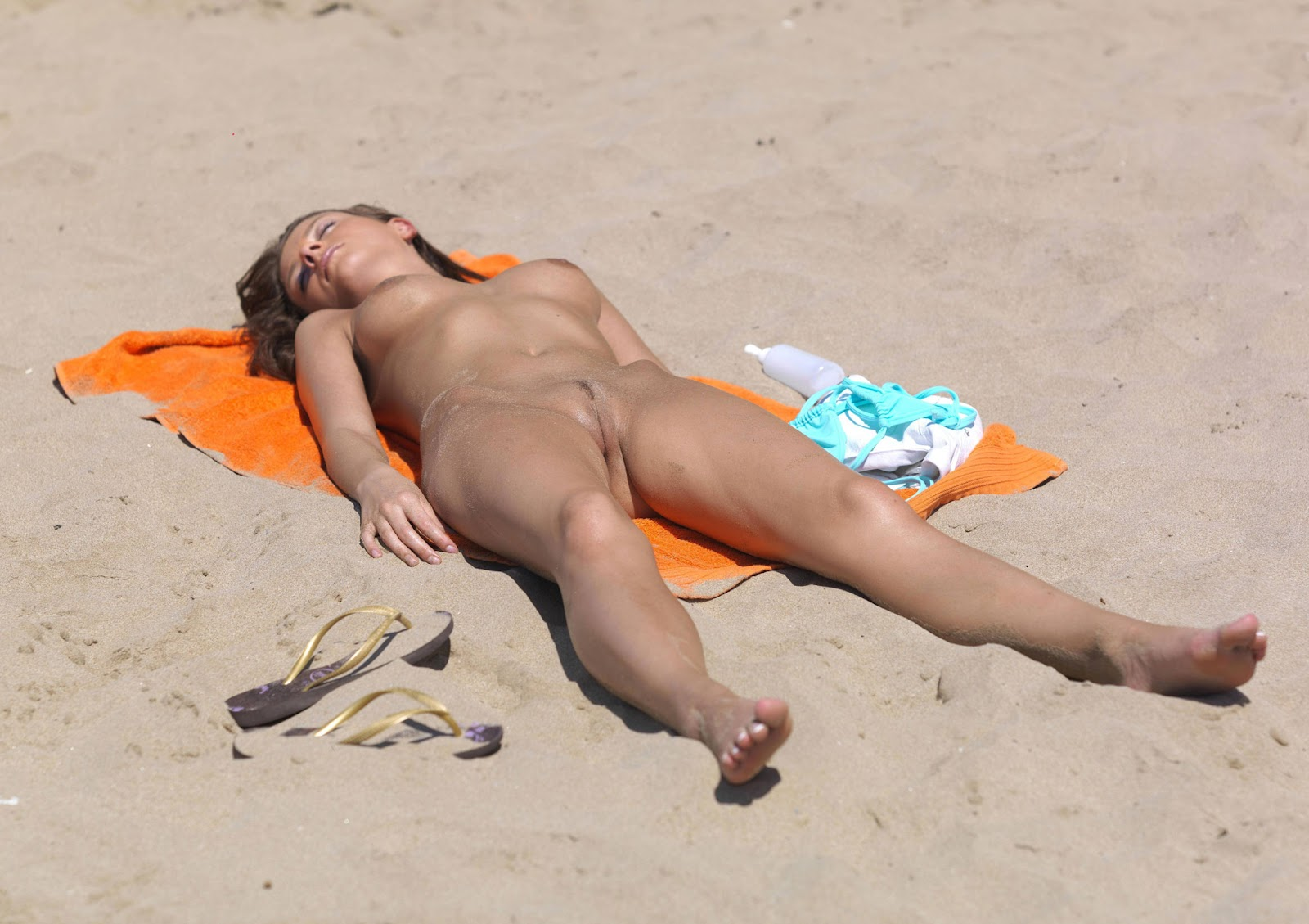 Nude beach women sunbathing