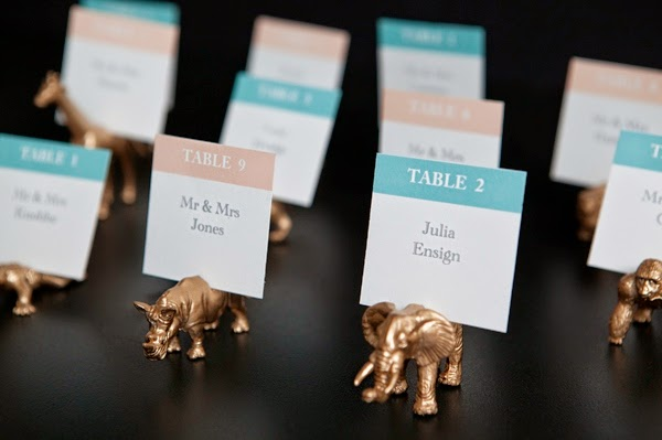 http://somethingturquoise.com/2013/08/02/diy-gold-painted-toy-animal-escort-cards/