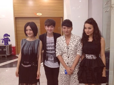 "Greyson with the hosts of the ""Happy Camp"" TV show"