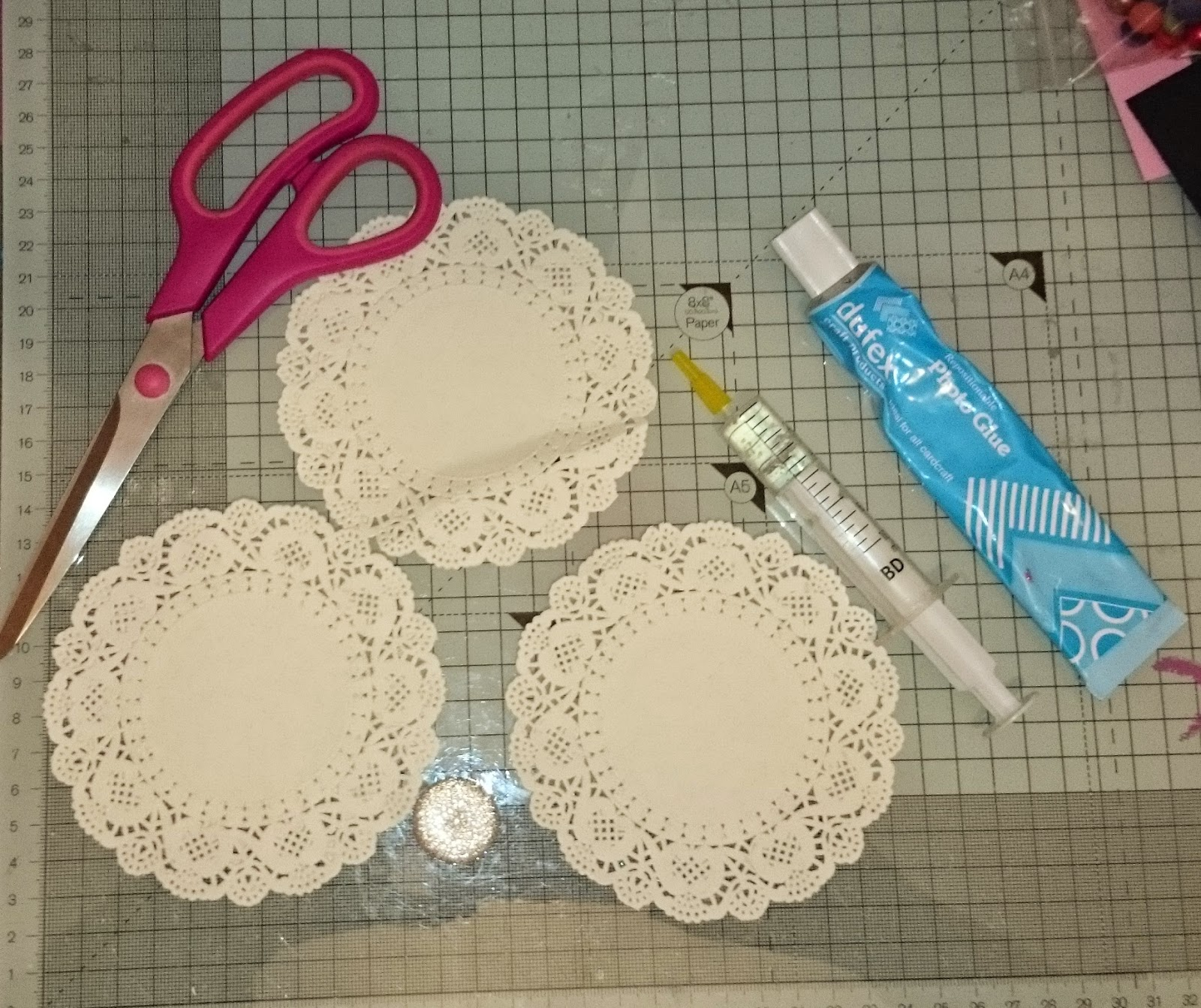 Cuddlys crafty creations scribble scrap paper doily flowers start by cutting into the centre of the doilies as in the following 2 picture on the 3rd doily you will need to cut in one place from the centre to the mightylinksfo
