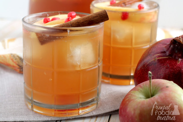 Warm spices, sweet pomegranate, and crisp apples come together perfectly in this Spiced Pomegranate Apple Cider Sangria. It will become your go-to cocktail for holiday entertaining!