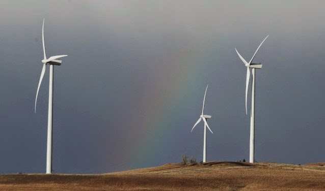 A rainbow is the backdrop for wind turbines at the Smoky Hill Wind Farm near Ellsworth, Kan., Monday, Feb. 20, 2012. (Credit: AP/Orlin Wagner) Click to enlarge.