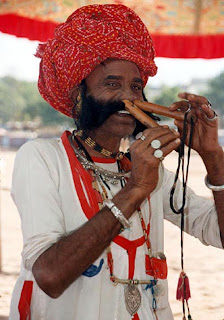 The Man Playing Flute With Nose