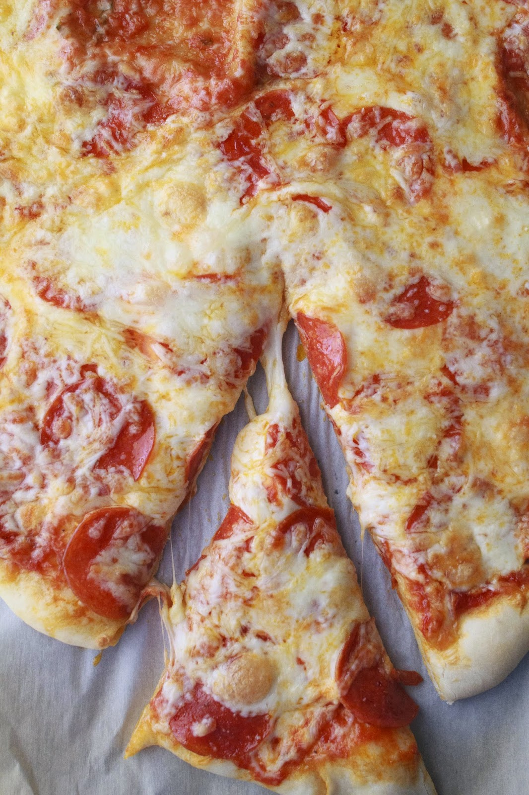 Homemade Pepperoni Pizza that is super easy to make and tastes better than any delivery!  www.mynameissnickerdoodle.com