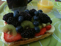 blackberries, blueberries, strawberries, bananas, kiwi fruit and waffles