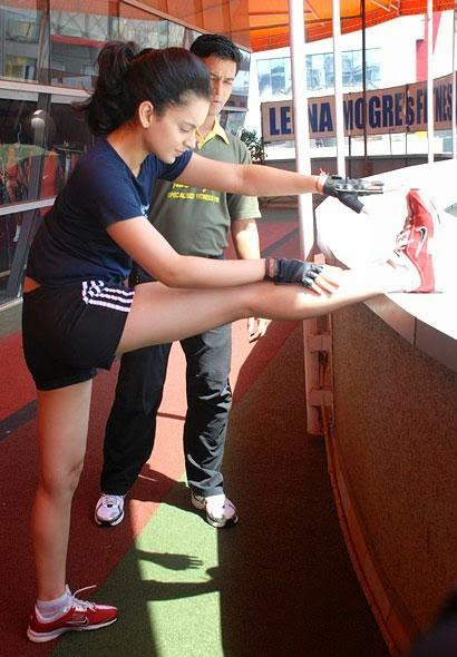 Coogled actress kangana ranaut at gym workout pictures