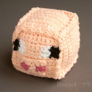http://www.breadandwithit.com/crochet-minecraft-pig-toy/