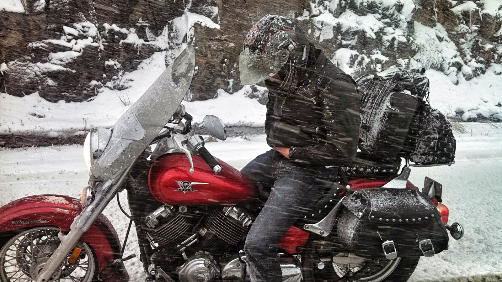 motorcycle rider wolf creek pass snow