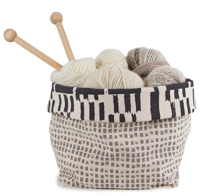 fabric bin holding yarn and knitting needles