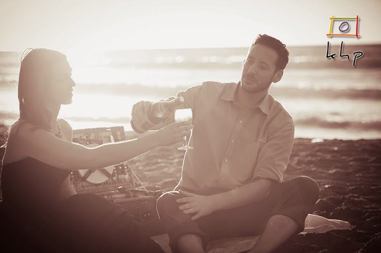 Sharing some snack or a light meal at the beach with some wine.