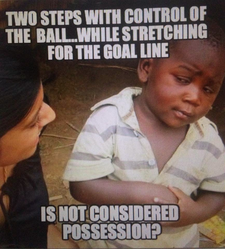 two steps with control of the ball.. while stretching for the goal line. Is not considered possession?