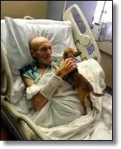 Man in hospital bed with his dog