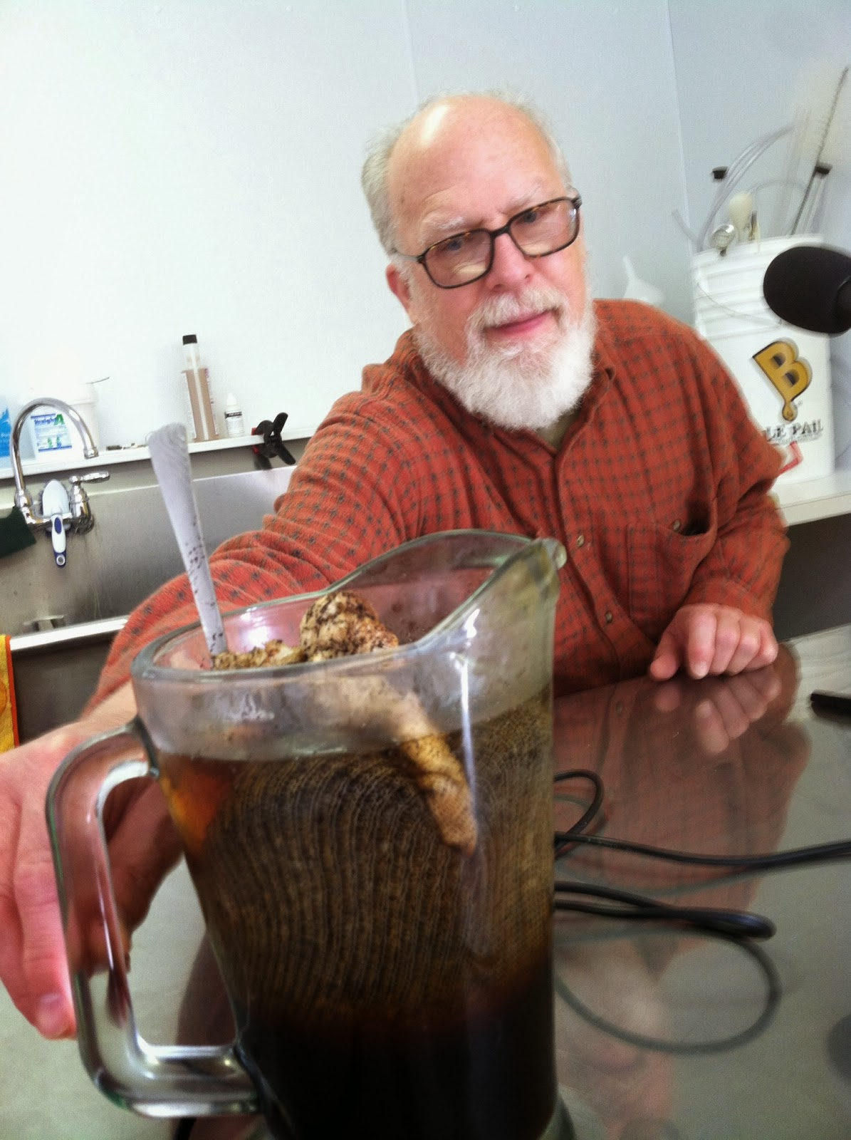 Doug Griffith displays a pitcher of cold brewed coffee