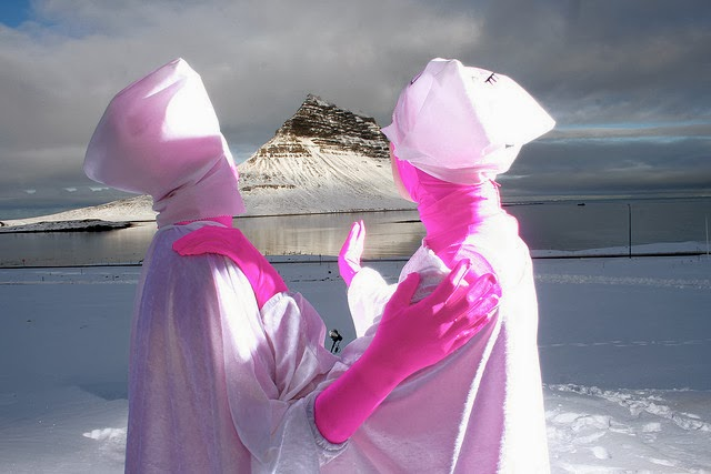 behind the scenes of WEIRD GIRLS ep.7 by Sara Vilbergs, Iceland. pink bodysuits, two girls dressed in white with esoteric hats, glacier, weird neon pair