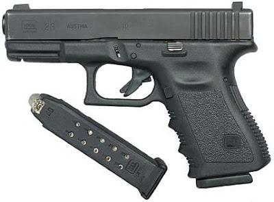 автоматический пистолет Glock 23 (Глок) с обоймой фото
