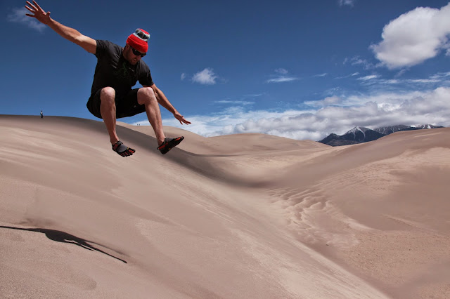 A guy flying through the air at Great Sand Dunes National Park in southern Colorado.