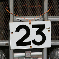 Photograph of a sign showing the number 23