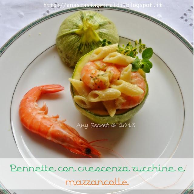 pennette con crescenza, zucchine e mazzancolle servite nelle zucchine tonde