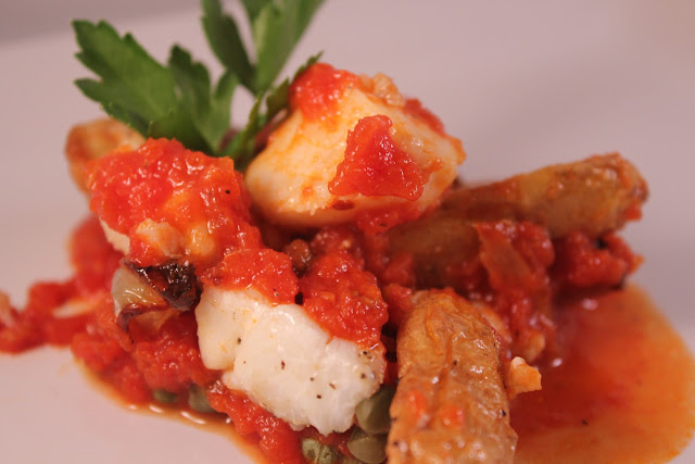 Haddock and fingerling potatoes in tomato sauce