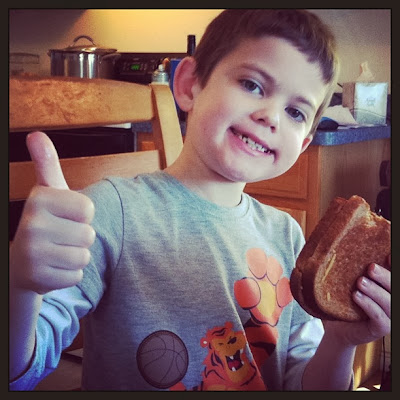 Boy enjoying a dairy free grilled cheese