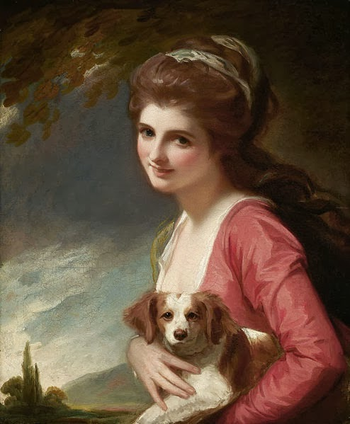 Image of a girl, sitting with a dog, smiling