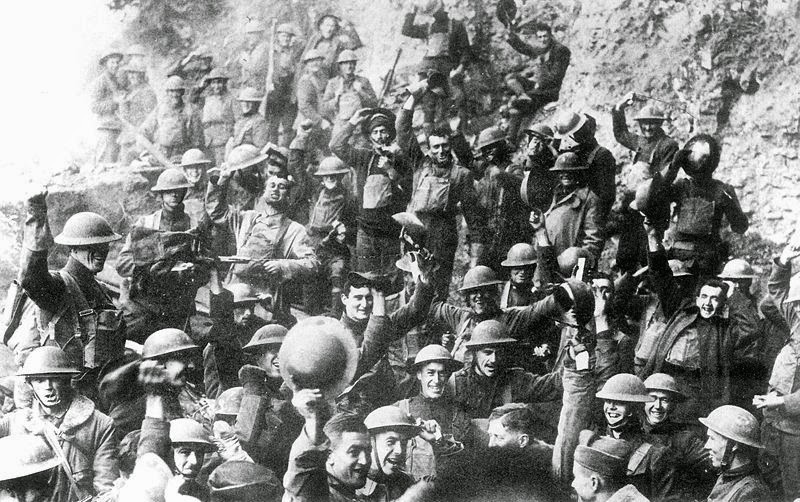 Men of US 64th Regiment, 7th Infantry Division, celebrate the news of the Armistice