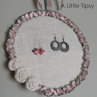 http://www.alittletipsy.com/2011/04/diy-under-5-make-earring-holder.html