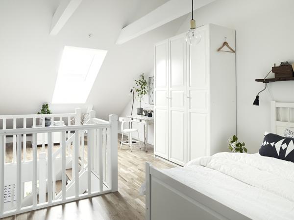 dormitorio apartamento nórdico con toques clásicos