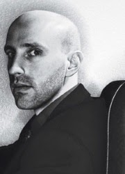 Black and white photo of Brian K. Vaughan, a bald white man.