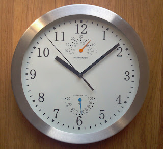 analog clock silver outside with the time set at 8 after 10