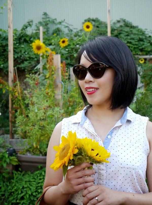 Ray-Ban cat-eye shades and a swiss dot JACHS Girlfriend blouse