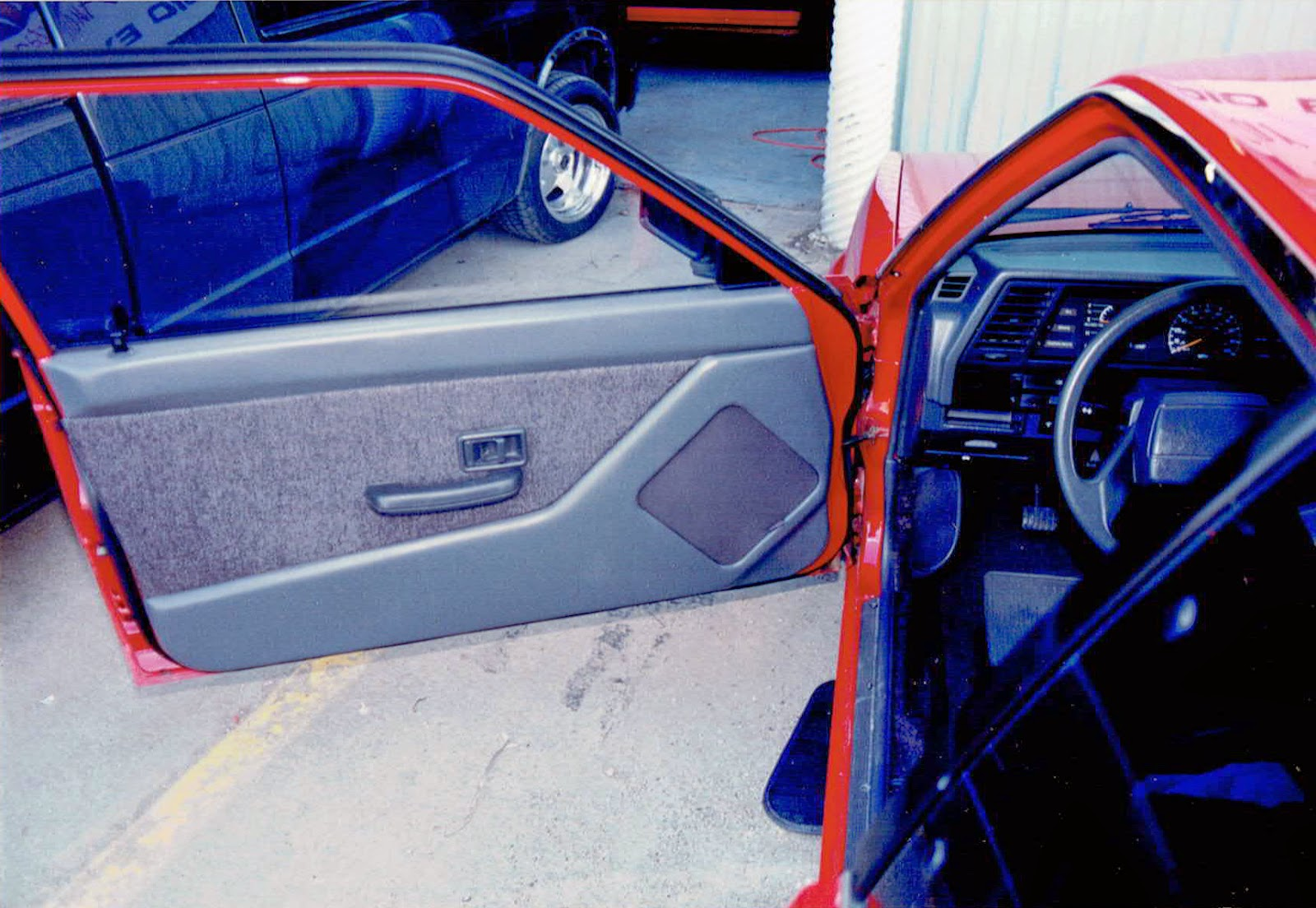Photo of the driver door of Alberto A Lopez's 1991 Red NIssan Sentra