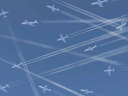 France O'Brien image of many, many jet planes all with vapour trails, in a beautiful blue sky.