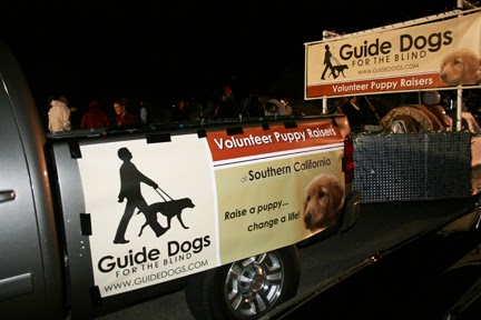 "Sign reads on truck with GDB logo: Volunteer Puppy Raisers - Southern CA. ""Raise a puppy...change a life."""