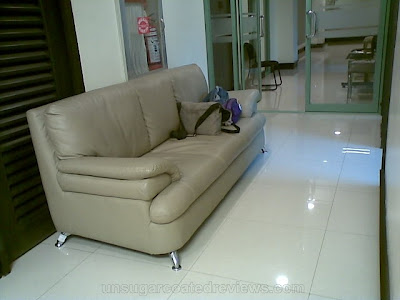 couch in the waiting room of MEDIcard Skin and Body Laser and Aesthetic Care Center