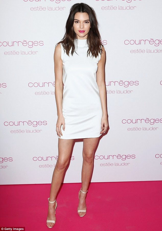 Kendall Jenner in a sleeveless white mini dress at the Courreges and Estee Lauder Dinner Party in Paris