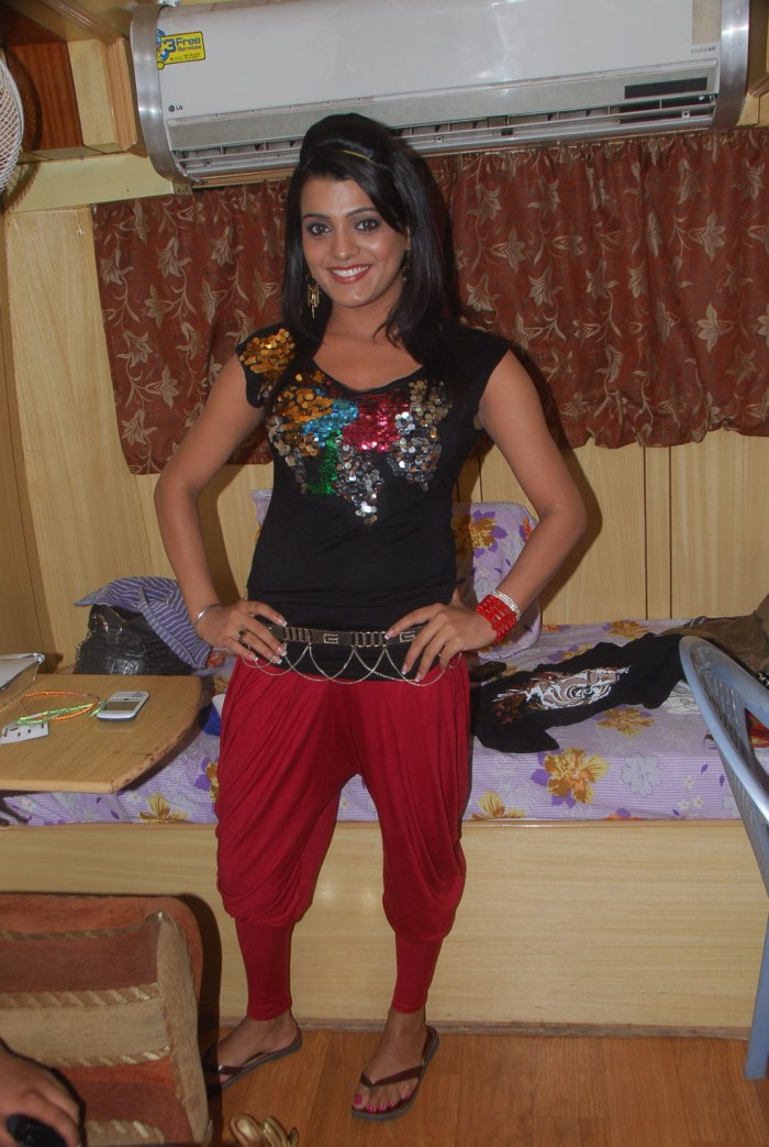 Tashu Kaushik Sizzles in Black Top,Red Pant Pics
