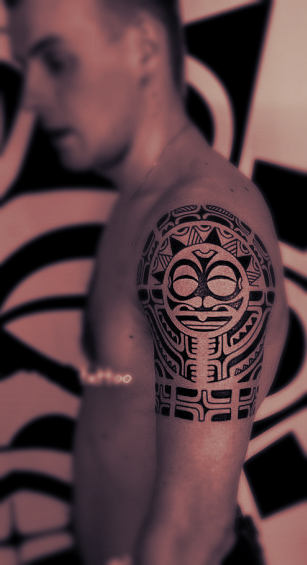 A typical tribal totem tattoo on the arm