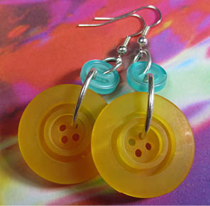 Fun edgy drop dangle earrings have big yellow buttons hanging from smaller teal buttons