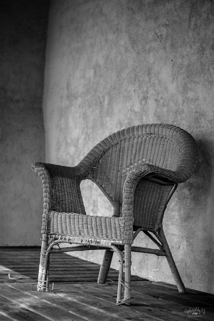 lone wicker chair on a deck