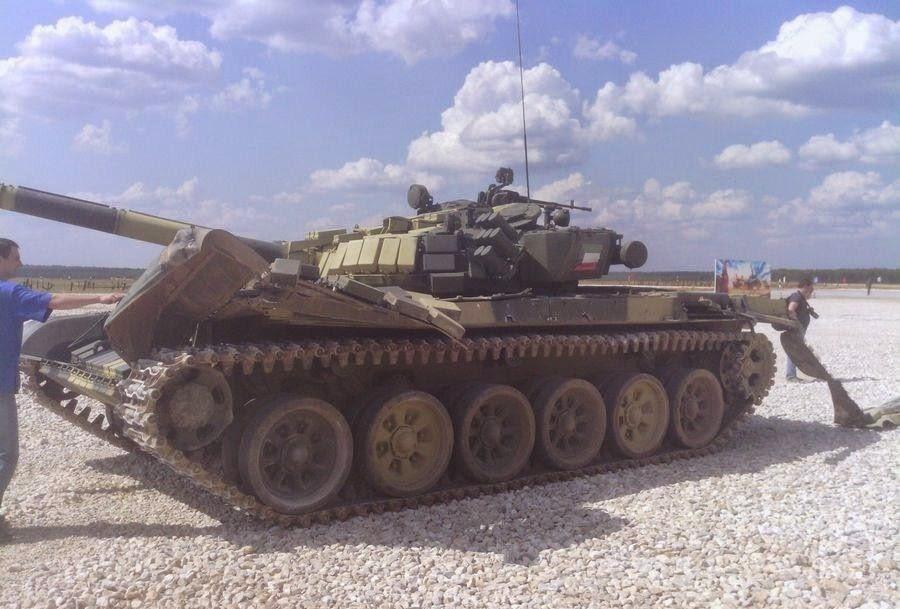 http://4.bp.blogspot.com/-X5IxRZ_6ZUY/U-H4JB0fNxI/AAAAAAAAInQ/oc-0rCMp1Lk/s1600/Kuwaiti+team+manages+to+smash+T-72+Tank+during+Tank+Olympics+2014.jpg