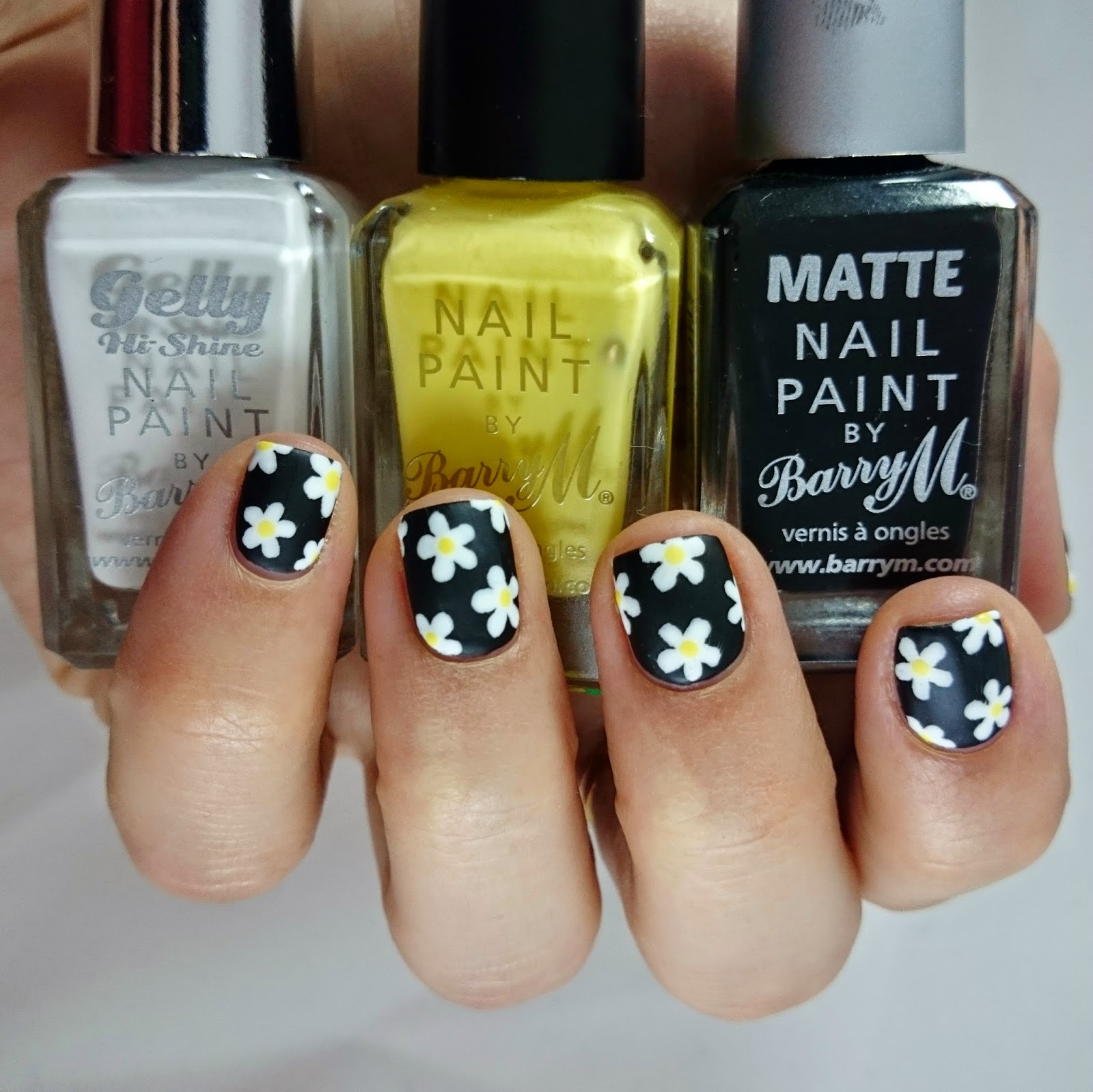 Dahlia Nails: Black Daisy Print Mani