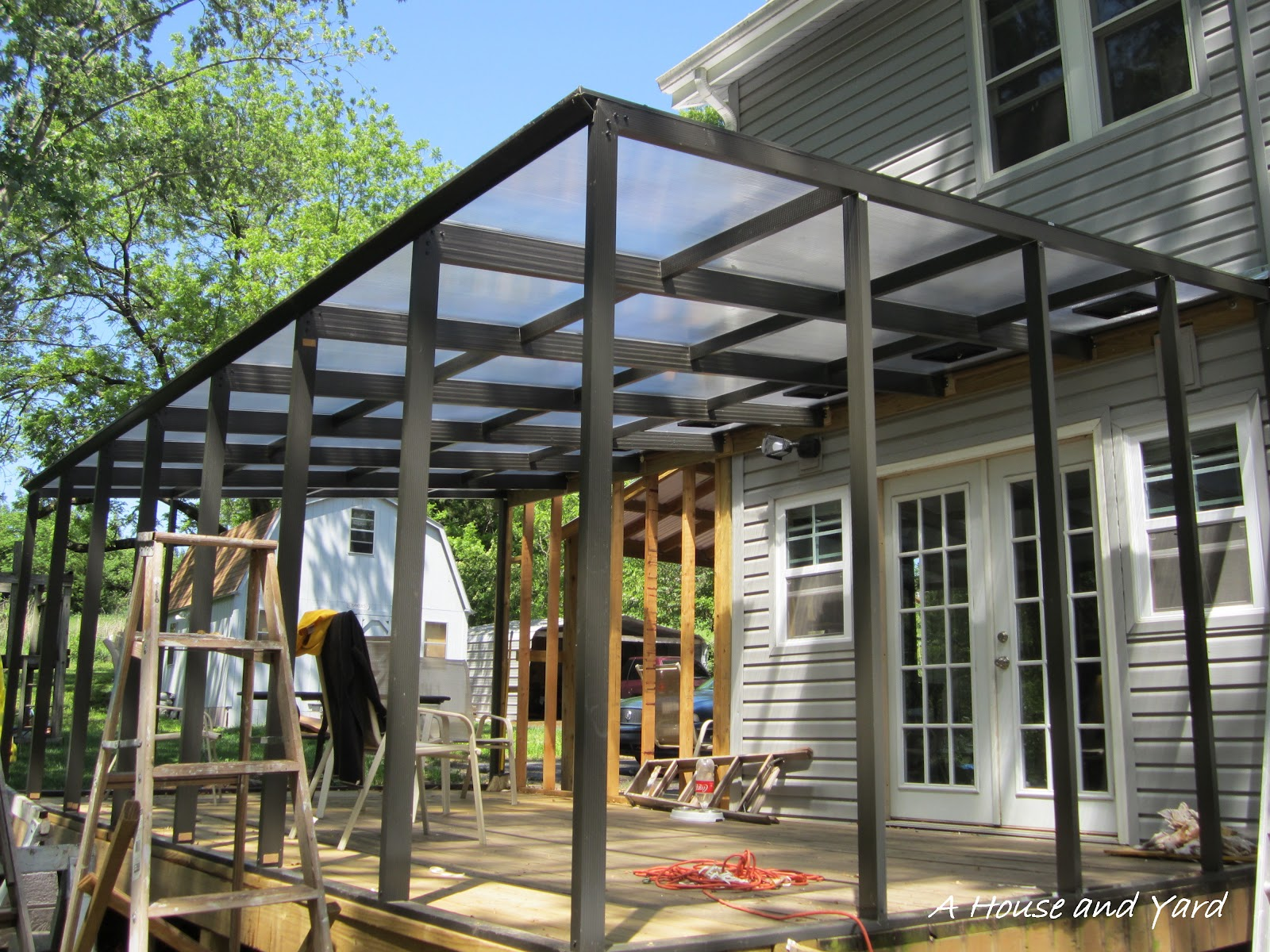 a house and yard sunroom project