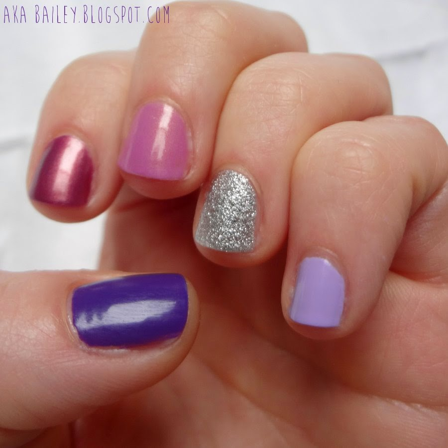 Multi colored purple nails with a silver glitter accent