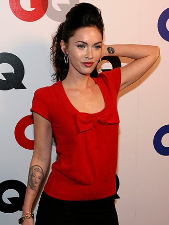 megan fox belly button. Megan Fox is removing her Marilyn Monroe tattoo ...