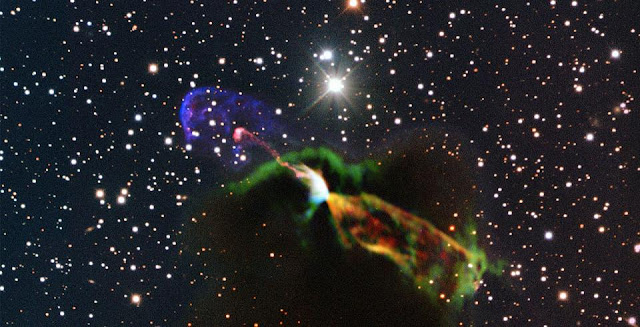 This unprecedented image of Herbig-Haro object HH 46/47 combines radio observations acquired with the Atacama Large Millimeter/submillimeter Array (ALMA) with much shorter wavelength visible light observations from ESO's New Technology Telescope (NTT). The ALMA observations (orange and green, lower right) of the newborn star reveal a large energetic jet moving away from us, which in the visible is hidden by dust and gas. To the left (in pink and purple) the visible part of the jet is seen, streaming partly towards us.  Credit:  ESO/ALMA (ESO/NAOJ/NRAO)/H. Arce. Acknowledgements: Bo Reipurth