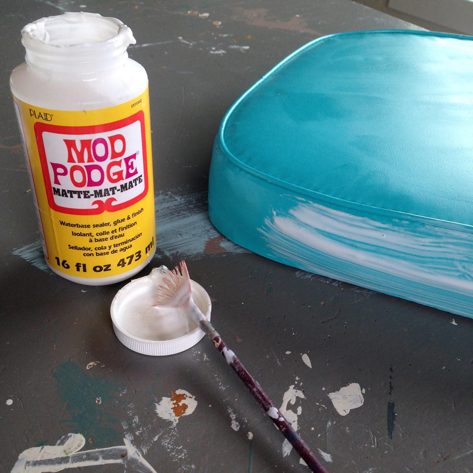 Repairing a tip in vinyl using facric and mod podge